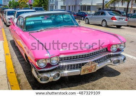 Miami, Florida, United States - April 8, 2012: front of the luxurious vintage pink Cadillac Eldorado on a street near Ocean Drive in Miami Beach. Miami Beach is famous for its classic cars.