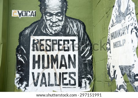 MIAMI, FLORIDA, USA - JUNE 28; Respect human values street art  image of destitute man with sign pleading for respect for the needy on June 28, 2012 in Wynwood, Miami., USA - stock photo