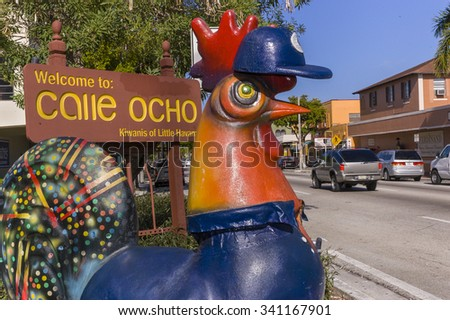 MIAMI, FLORIDA, USA - MAY 2004: Sign on Calle Ocho (8th Street), the heart of Little Havana, a Cuban-American neighborhood. - stock photo