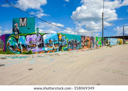 Miami, Florida USA - October 4, 2015: The  urban Wynwood area in midtown has become a popular tourist destination for the colorful graffiti art on the facades of commercial warehouse style buildings.
