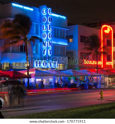 MIAMI - JANUARY 3: Ocean drive buildings on january 3rd 2014 in Miami South Beach, Florida. Art Deco district architecture is one of the main tourist attractions in Miami. - stock photo