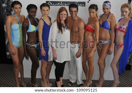 MIAMI - JULY 21: Designer Nikki Silverthorne (C) and models pose at the Kooey 2013 Swimwear Presentation during Mercedes-Benz Swim Fashion Week on July 21, 2012 in Miami, FL - stock photo