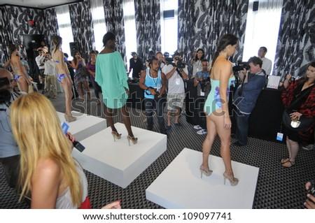 MIAMI - JULY 21:  Kooey Swimwear Presentation for Spring/ Summer 2013 during Mercedes-Benz Swim Fashion Week on July 21, 2012 in Miami, FL - stock photo