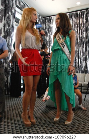MIAMI - JULY 21: Miss USA Olivia Culpo (L) at the Kooey Swimwear Presentation for Spring/ Summer 2013 during Mercedes-Benz Swim Fashion Week on July 21, 2012 in Miami, FL - stock photo
