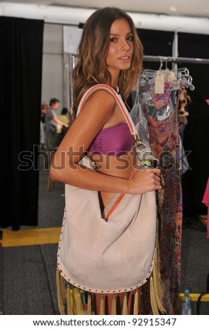 MIAMI - JULY 17: Model demonstrating bag backstage at the Cia Maritima Collection for Spring/ Summer 2012 during Mercedes-Benz Swim Fashion Week on July 17, 2011 in Miami, FL - stock photo