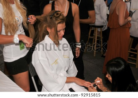 MIAMI - JULY 17: Model getting ready backstage at the Cia Maritima Collection for Spring/ Summer 2012 during Mercedes-Benz Swim Fashion Week on July 17, 2011 in Miami, FL - stock photo