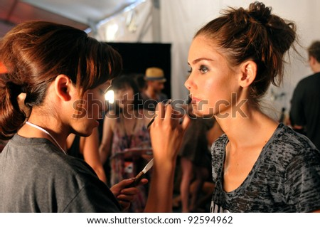 MIAMI - JULY 15: Model getting ready backstage at the White Sands Australia Swimsuit Collection for Spring/ Summer 2012 during Mercedes-Benz Swim Fashion Week on July 15, 2011 in Miami, FL - stock photo
