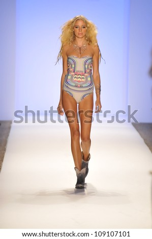 MIAMI - JULY 21: Model walks runway at the Mara Hoffman Swimwear Collection for Spring/ Summer 2013 during Mercedes-Benz Swim Fashion Week on July 21, 2012 in Miami, FL