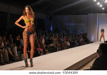 MIAMI - JULY 18: Model walks runway at the Sonia Vera Collection for Spring/ Summer 2012 during Mercedes-Benz Swim Fashion Week on July 18, 2011 in Miami, FL - stock photo