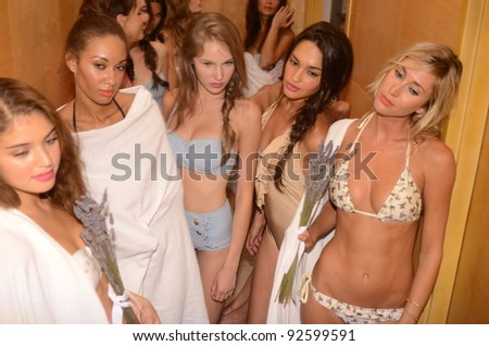 MIAMI - JULY 15: Models demonstrating swimsuits at the Wildfox Swim 2012 Event at penthouse of Raleigh hotel during Mercedes-Benz Swim Fashion Week on July 15, 2011 in Miami, FL - stock photo