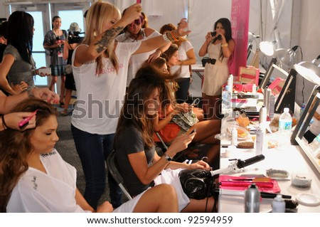 MIAMI - JULY 15: Models getting ready backstage at the Poco Pano Swimsuit Collection for Spring/ Summer 2012 during Mercedes-Benz Swim Fashion Week on July 15, 2011 in Miami, FL - stock photo