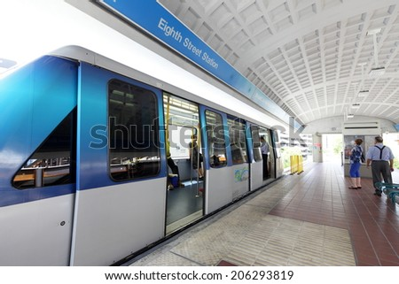 MIAMI - JULY 15: Passengers getting on and off of the Miami Metrorail and People Mover  on July 15, 2014 at Brickell FL.  - stock photo