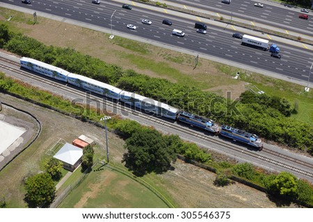 MIAMI - JUNE 12: Amtrak train in motion near I95 in Miami FL June 12, 2015 in MIami FL. Amtrak is a government funded privately owned railroad company opearting thorughout the us since 1971.  - stock photo