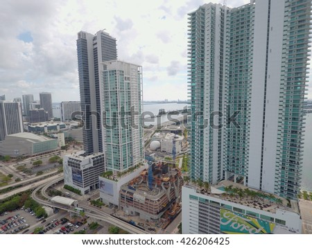 MIAMI - MARCH 15: Aerial photo of 1000 Museum luxury residences under construction designed by the recently deceased architect Zaha Hadid located at 1000 Biscayne Boulevard March 15, 2016 in Miami FL - stock photo