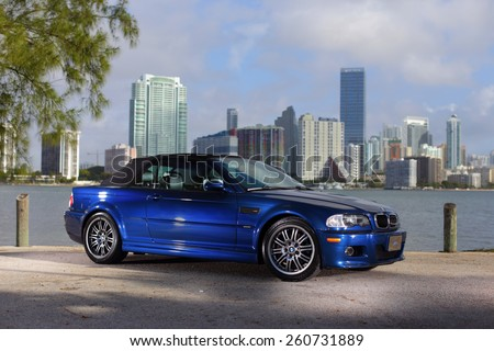 MIAMI - MARCH 10: Image of a BMW M3 photographed at Key Biscayne with Brickell Bay in the Background March 10, 2015 in Miami FL. BMW is a German automobile manufacturing company.  - stock photo