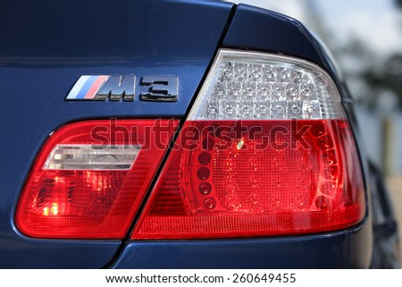 MIAMI - MARCH 10: Image of a 2006 BMW M3 tail light and emblem shot at Key Biscayne with Brickell in the background March 10, 2015 in Miami FL - stock photo