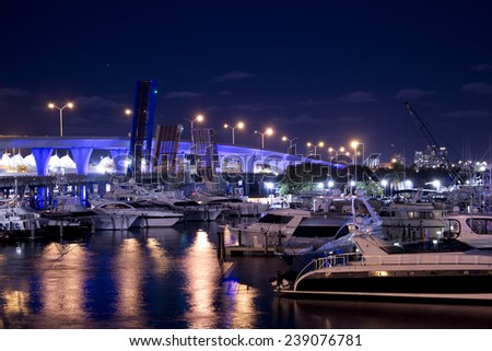 Miami marina at night with dramatic sky