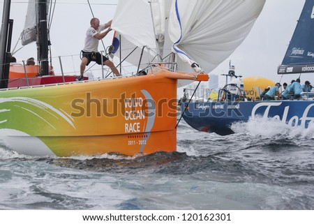 MIAMI - MAY 19: Team Sanya's unidentified bowman takes down spinnaker  during In-port race of 2011-2012 Volvo Ocean Race stop over in Miami on May 19, 2012 - stock photo
