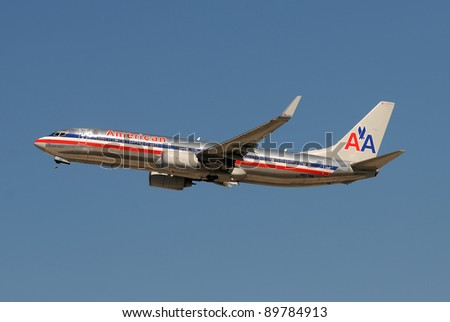 MIAMI, NOVEMBER 29: AMR, American Airlines' parent company has filed for bankruptcy protection. American's typical Boeing 737 jet landing at Miami International Airport on Nov 29, 2011 - stock photo