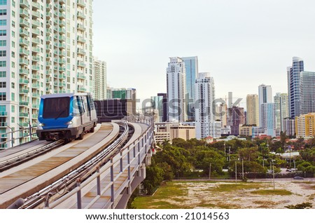 Miami Residential Buildings and Elevated Commuter Tracks With Automated Train Car