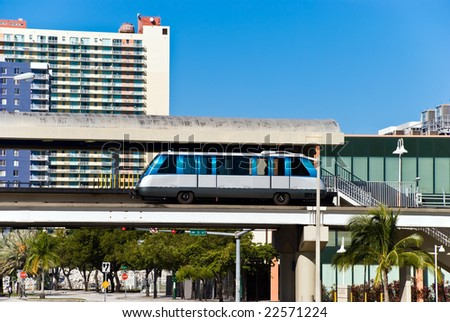 Miami Residential Buildings and Elevated Commuter Tracks With Automated Train Car - stock photo