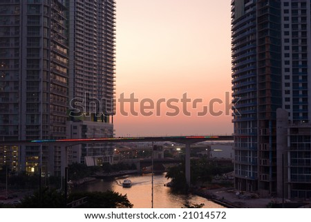 Miami River at Sunset With Colorful Elevated Tracks - stock photo