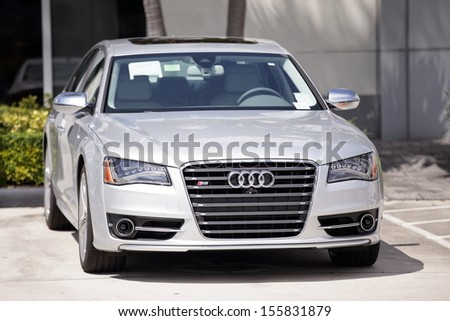 MIAMI - SEPTEMBER 26: Stock image of a 2014 Audi S8 on display at a car dealership in Miami September 16, 2013 in Miami, USA.  - stock photo
