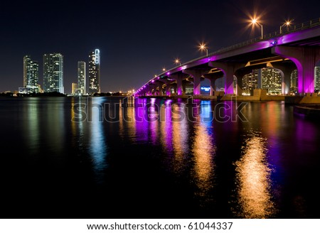 Miami Skyline along the MacArthur Causeway Bridge. - stock photo