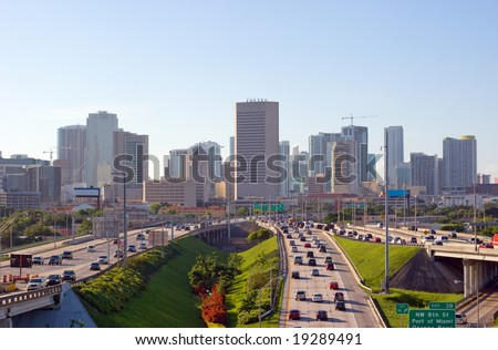 Miami Skyline and Highways and Morning Rush Hour Traffic - stock photo