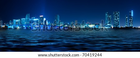 Miami skyline at night with beautiful water reflections - stock photo