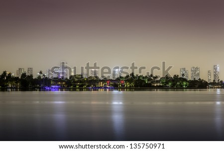 Miami skyline by night with illuminated downtown - stock photo