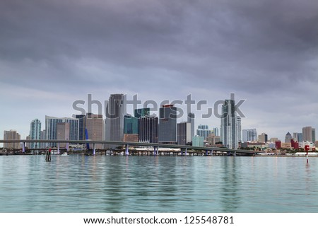 Miami Skyline. Image of Miami downtown skyline during cloudy evening. - stock photo