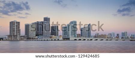 Miami Skyline. Panoramic image of Miami skyline at sunrise. - stock photo