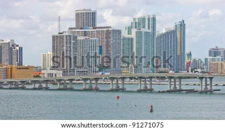 Miami skyline with causeway - stock photo