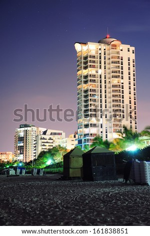 Miami south beach at night with hotel buildings - stock photo