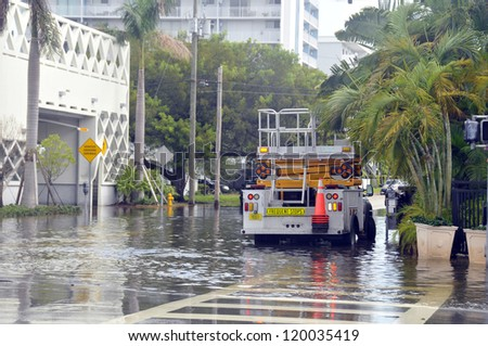 MIAMI - SOUTH BEACH - FLORIDA, OCTOBER 28: Electricity truck in Miami South beach Lenox Ave flood aftermath of Hurricane Sandy on october 28 2012 in Miami South Beach. - stock photo