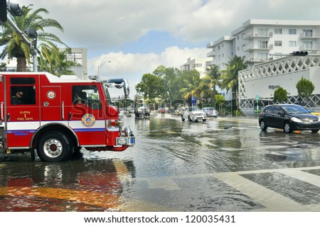 MIAMI - SOUTH BEACH - FLORIDA, OCTOBER 28:  Firefighter truck in Miami South beach Lenox Ave flood aftermath of Hurricane Sandy on october 28 2012 in Miami South Beach. - stock photo