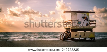 Miami South Beach sunrise with lifeguard tower and coastline with colorful cloud and blue sky, Florida, USA - stock photo