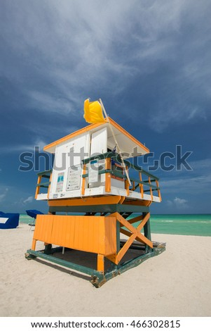 Miami South Beach with lifeguard tower and coastline with colorful cloud and blue sky.
