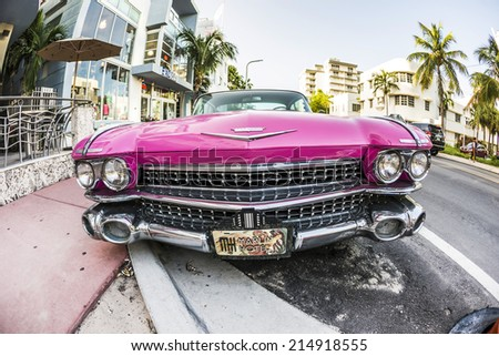 MIAMI, USA - AUG 18, 2014 : Cadillac Vintage car parked at Ocean Drive in Miami Beach, Florida. Art Deco architecture in South Beach is one of the main tourist attractions in Miami - stock photo