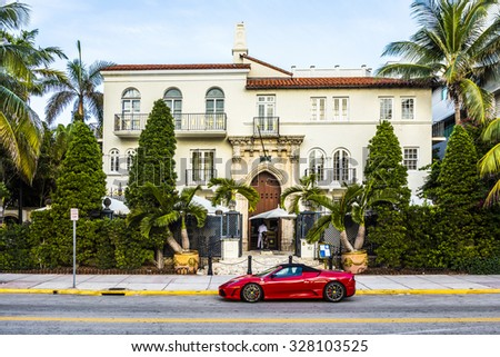 MIAMI, USA - AUG 20, 2014: Ferrari in front of Versace mansion. In 1997 the world gasped as Gianni Versace was shot to death on the doorstep of his Miami South Beach mansion in Miami, USA. - stock photo