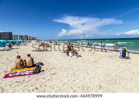 MIAMI, USA - AUG 1, 2013: people enjoy the hot summer day at south beach in Miami, USA. South beach is the famous beach at art deco district near ocean drive street.