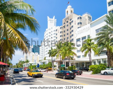 MIAMI,USA - AUGUST 8,2015 : Street scene with traffic and  famous hotels at Collins Avenue in Miami Beach - stock photo