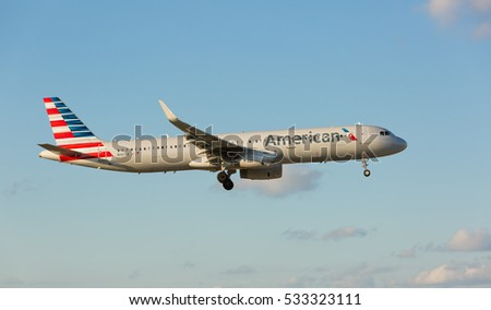 MIAMI, USA - DECEMBER 10, 2016: American Airlines Airbus A321 aircraft landing at the Miami International Airport.