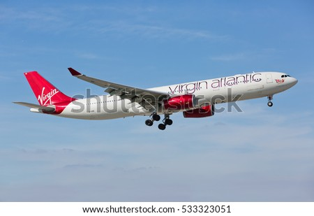 MIAMI, USA - DECEMBER 10, 2016: An Airbus A 330-300 plane from Virgin Atlantic landing at the Miami International Airport.