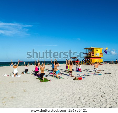 MIAMI, USA - JULY 31: people enjoy the fitness course on July 31, 2013 in Miami, USA. South beach is famous for its wooden lifeguard towers which are designed in Art deco style. - stock photo