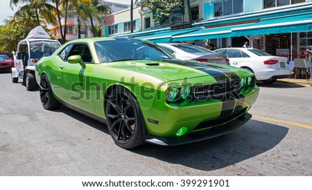 MIAMI, USA - MARCH 14, 2016: Dodge Challenger SRT sports car in Ocean Drive. The Dodge Challenger is the name of three different generations of American automobiles produced by Dodge. - stock photo