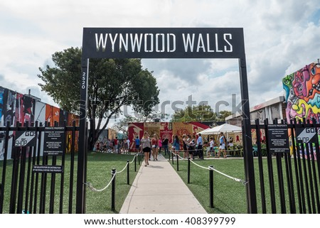 MIAMI, USA - MARCH 19, 2016: Wynwood Wall entrance with people. The Wynwood Art District Association was founded in early 2003 by a group of art dealers, artists and curators. - stock photo