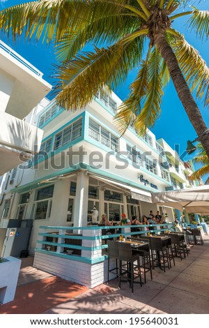 MIAMI,USA - MAY 21,2014 : Ocean Drive hotels and buildings in Miami Beach, Florida. Art Deco architecture in South Beach is one of the main tourist attractions in Miami - stock photo