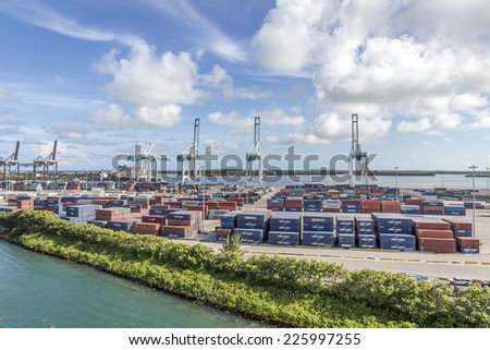 MIAMI, USA - SEPTEMBER 06, 2014 : The Port of Miami with containers and cranes on the background on September 06, 2014 in Miami. - stock photo